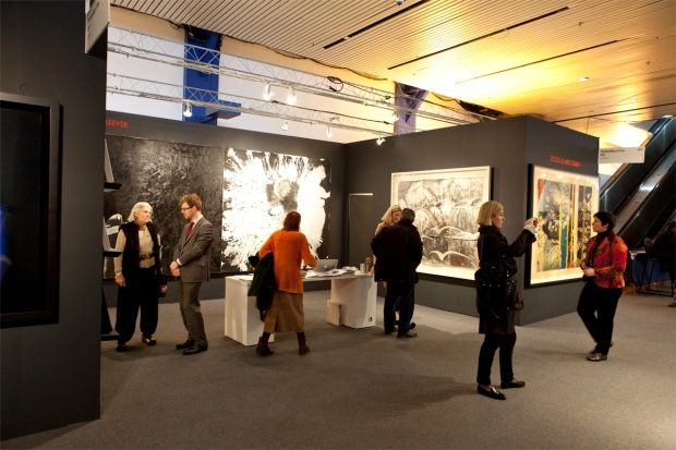 Visitors discussing the art at the Armory Show