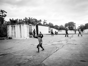 Kids play soccer on a coffee patio.